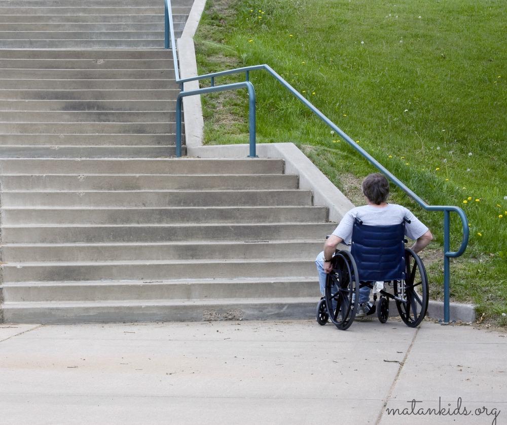 wheelchair at base of stairs; Matan